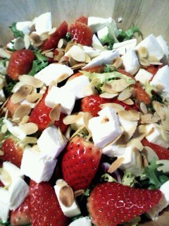 Strawberry almond salad with chicken and feta cheese.